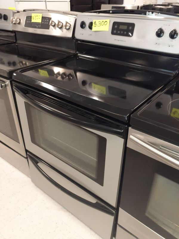 Frigidaire stainless steel electric stove in excellent condition with 90 days warranty