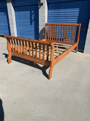 Queen sleigh bed frame real solid pinewood very heavy duty and sturdy for Sale in Victorville, CA