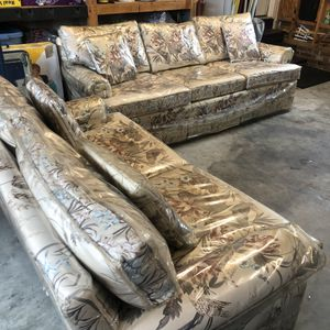 Couch and love seat protected by plastic covering for Sale in Angier, NC