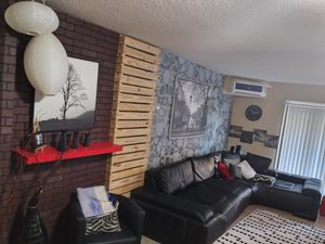 Selling modern contemporary sectional sofa and wall decorations and pantings couch black leather for Sale in Atlanta, GA