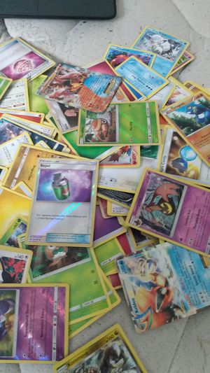350+ pokemon cards, 11 rainbow cards 2 EX's and card cases for Sale in Northglenn, CO