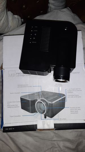 Led mini projector one year warranty included for Sale in Portland, OR