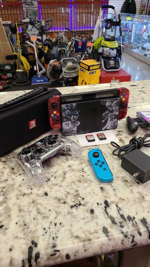 Nintendo Switch with Games and extra remotes for Sale in Ontario, CA