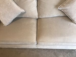 Ivory sofa with 2 pillows like new smoke pet kids free home always covered pick up in Gaithersburg md 20877 for Sale in Gaithersburg, MD