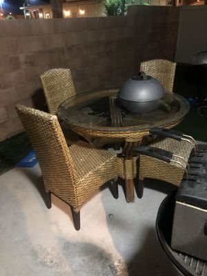 $50 Pier one wicker patio set. Table in excellent condition. 4 chairs, 1 chair is worn but still manageable. for Sale in Las Vegas, NV