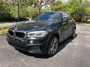 Gorgeous 2016 BMW X6 xDrive 4 x 4 completely and fully loaded leather panoramic sunroof navigation backup camera clean title good miles for Sale in Hollywood, FL
