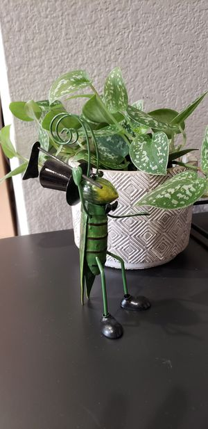 Metal grasshopper plant pot garden decor with top hat and gardening tool for Sale in Ontario, CA