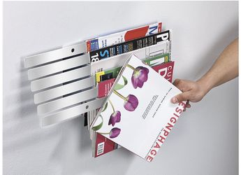 Umbra Illuzine metal wall-mount magazine Rack for Sale in Riviera Beach, FL