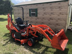2018 Kubota BX23S with bucket, backhoe, 5' mow deck. This tractor only has 130 hours on it. Looks and handles like new. This tractor and al attachm for Sale in Geneva, FL
