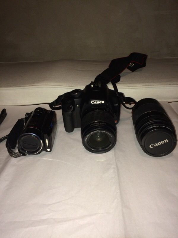 Canon xsi w/ extra lense/ canon vixia hd camcorder