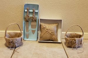 Wedding toppers, ring pillow, flower baskets, cake knives and spatula for Sale in Katy, TX