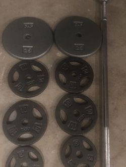 100 Lbs Plates And One Chrome Barr....25x2...10x4....5x2 for Sale in Forney,  TX