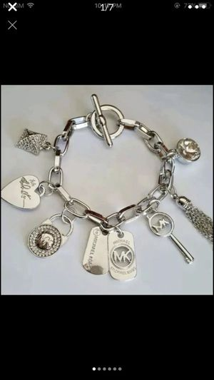 Mk Michael kors charms silver tone white gold tone bracelet for Sale in Silver Spring, MD