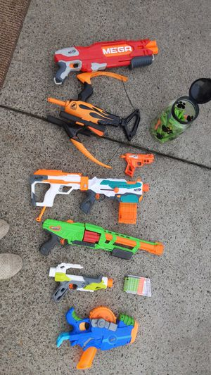 Tons of Nerf guns with a bucket almost full of Nerf ammo for Sale in Brooks, OR