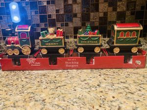 CHRISTMAS TRAIN STOCKING HANGINGS SET OF FOUR for Sale in Washington, DC