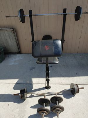 Exercise Bench with bars and weights for Sale in San Bernardino, CA