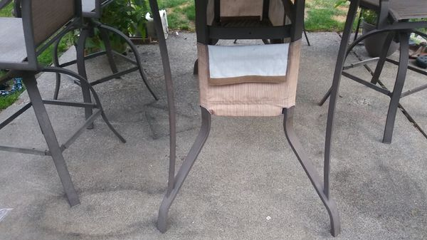 Bistro table with 5 Captain chairs that swivel