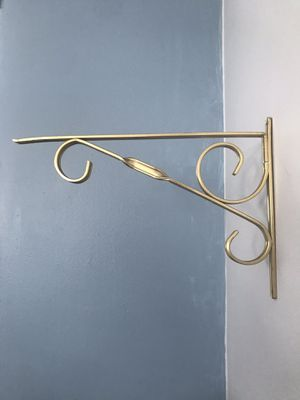 Gold wall mount hanging plant stands Metal brackets $5 each or Priced $15 for all 4. for Sale in Largo, FL