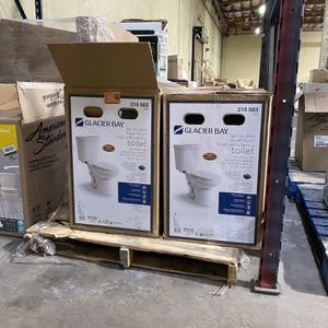 Glacier Bay 2-piece 1.1 GPF/1.6 GPF High Efficiency Dual Flush Complete Elongated Toilet in White, Seat Included for Sale in Los Angeles, CA
