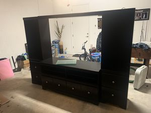 Full 4 piece entertainment center with 4 glass shelves. Both columns have lighting as well. Tons of storage and very clean. for Sale in West Palm Beach, FL