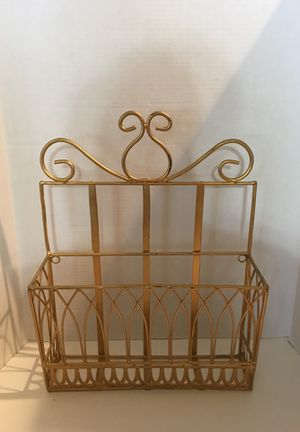 Gold magazine standing / hanging Rack for Sale in Las Vegas, NV