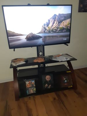 Phillips smart tv and tv stand for Sale in Wood River, IL