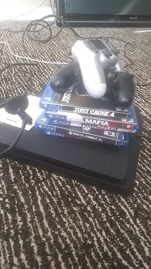 PlayStation 4, 5 games, 2 controllers for Sale in Traverse City, MI