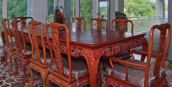 Hand carved Asian rosewood dining room set 114 inches long with 10 chairs, cushions and custom made protective top