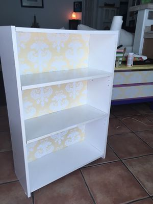 White and yellow bookcase for Sale in Las Vegas, NV