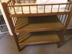 Changing table with pad and cover. Not used often. (Nursery for my grandson when he came to visit) Spot on table from lotion that leaked. Moving sale for Sale in Wood Dale, IL