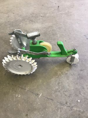 Cast iron walking craftsman Green And White Tractor Sprinkler for Sale in NEW ALEXANDRI, PA