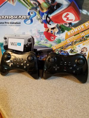 Nintendo Wii U Bundle Like New Mario 8 Deluxe Set Edition, Black Console, 32GB Harley Used just like New come with 2 extra controls. for Sale in Montclair, CA