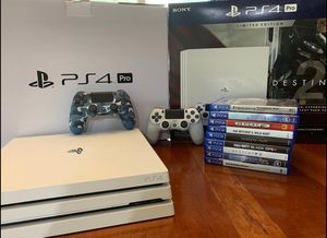PS4 pro with games + 2 controllers for Sale in Grand Haven, MI