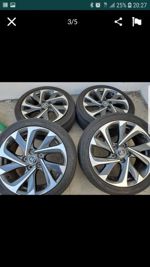 4 Toyota rims 17x7 with 50%life tires for Sale in Fullerton, CA