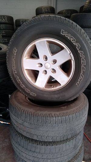 Stock jeep rims an tires for Sale in Vallejo, CA