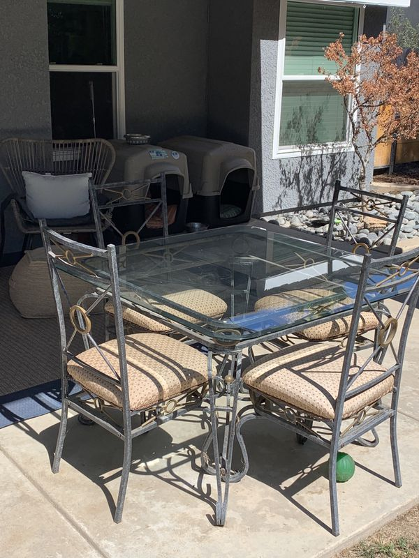 Glass Table and Four Chairs