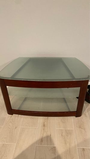 Glass TV stand for Sale in Melbourne, FL