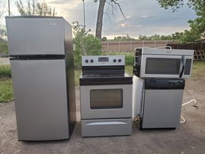 Stainless steel appliances set fridge stove dishwasher microwave all good working conditions set for $599 for Sale in Wheat Ridge, CO