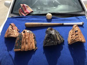 Wood bat 1 XL & 2 L adult 1 youth lefty gloves & ball $115 for Sale in Moreno Valley, CA