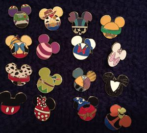 16 character Disney Mickey head tradable pin set for Sale in Orlando, FL