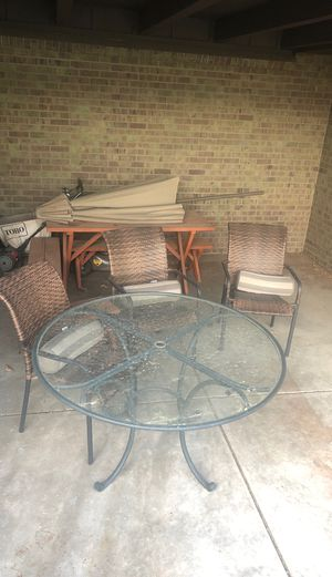 Patio set with umbrella, picnic table bundled in. for Sale in Denver, CO