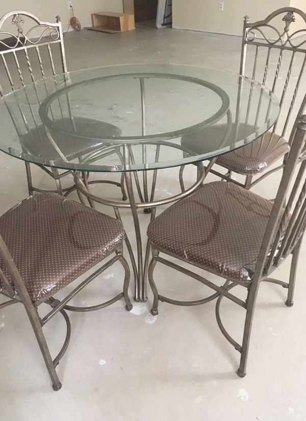 Metal kitchen table/ glass top and cabinet w/ mirror in the back