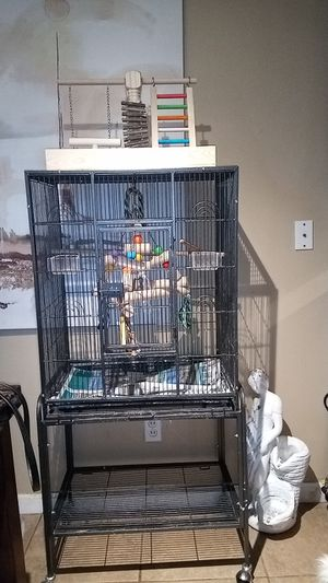 Bird cage with brand new toys and play ground set for Sale in St. Louis, MO