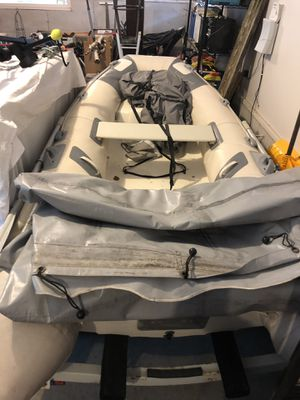 2004 West Marine Avon 310 Rib (hard bottom) and Mercury 2004 15 HP 2 stroke motor. Also includes trailer. for Sale in Traverse City, MI