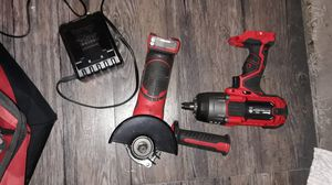 Half-inch impact drill and angle grinder plus battery and charger for Sale in Longmont, CO