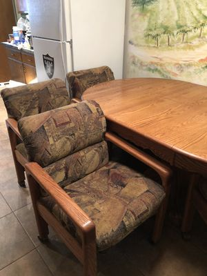 Solid oak oval kitchen table w/ 4 fabric chairs w/ coasters full size 68x44 folded size 45x44 $500.00 or best offer for Sale in Modesto, CA