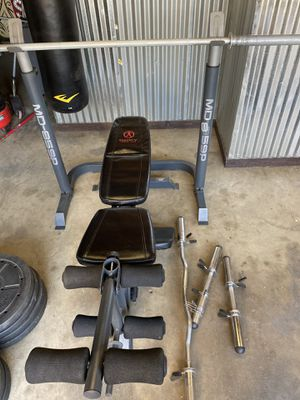 Marcy weight bench, bars, 35/25/10 plates in great shape!! for Sale in La Habra Heights, CA