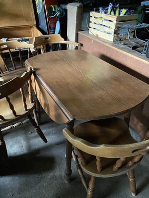 Small round kitchen table. Needs som TLC 4 chairs. One needs repair for Sale in Maple Valley, WA