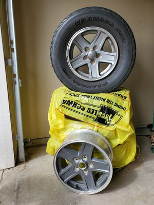 Price drop!! Jeep wheels $60 each (tires included) for Sale in Fresno, CA