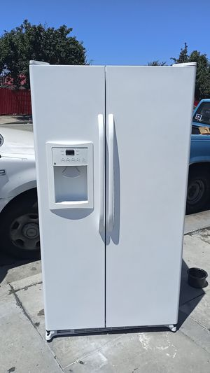 G:E white side by side refrigerator delivered & installed with a 30 day warranty for Sale in Los Angeles, CA